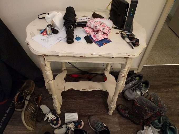 The table only, not the shrine of shoes surrounding it