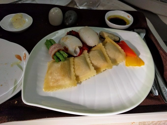 EVA Air TPE-JFK business class - mussel and squid with pumpkin ricotta cheese ravioli