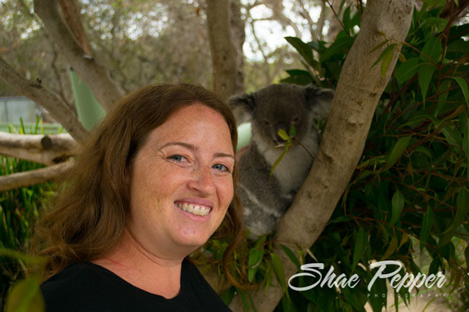 Shae petting a Koala at Australia Walkabout Wildlife Park