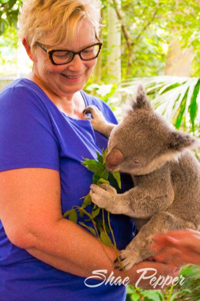 Mom holding a koala