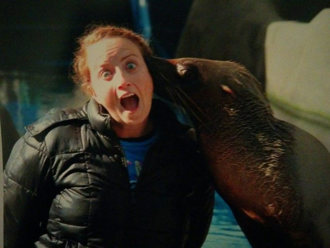 Shae getting kissed by a seal on our last trip to Australia