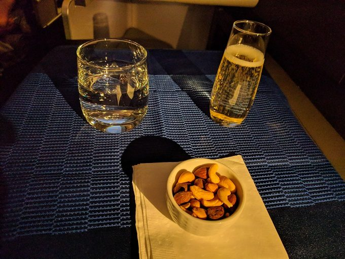 Water, champagne and warm nuts