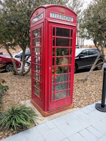 Red telephone box outside front of hotel