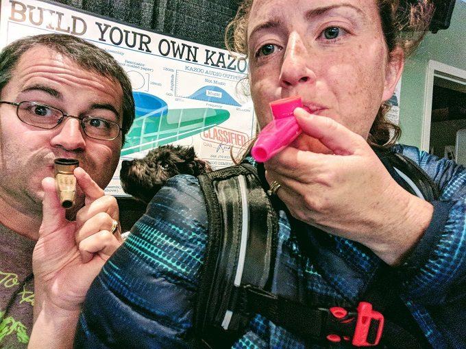 Testing out the kazoos we made at the Kazoobie Kazoo Factory